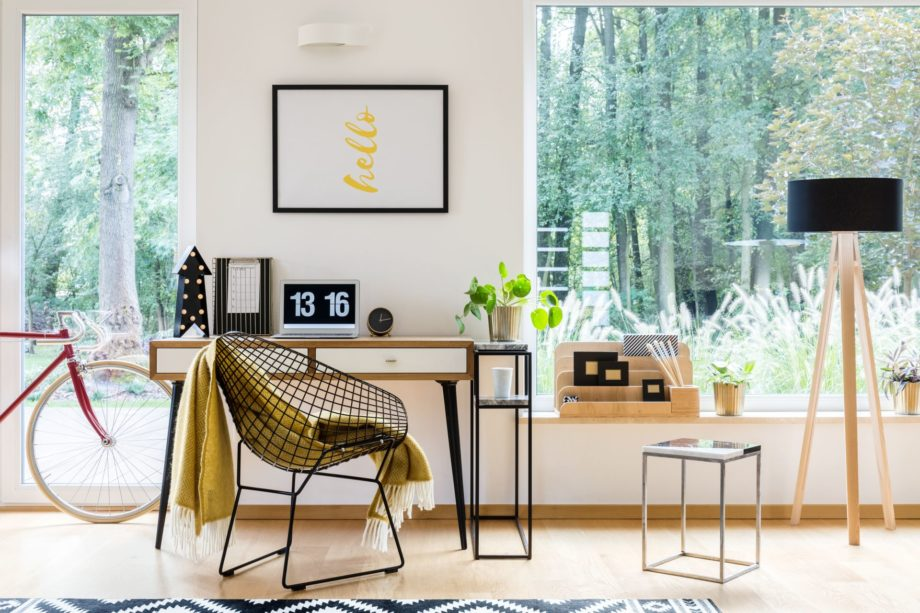 Wooden,Lamp,And,Stool,Next,To,A,Desk,With,Computer