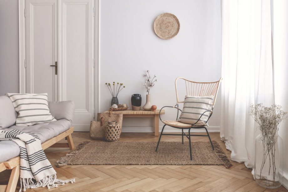 Armchair,On,Rug,Next,To,Bench,With,Plants,In,White