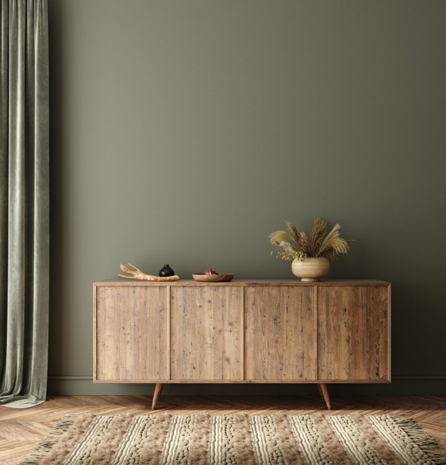 Commode,With,Decor,In,Living,Room,Interior,,Dark,Green,Wall