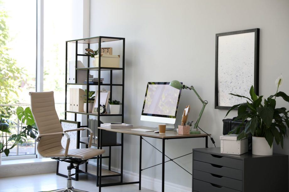 Comfortable,Office,Chair,Near,Desk,With,Modern,Computer,Indoors