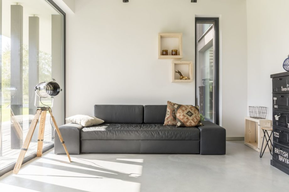 White,Living,Room,With,Black,Furniture,And,Window