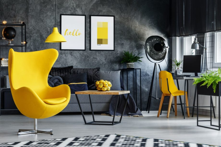 Designer's,Yellow,Chair,Next,To,Simple,Table,In,Living,Room